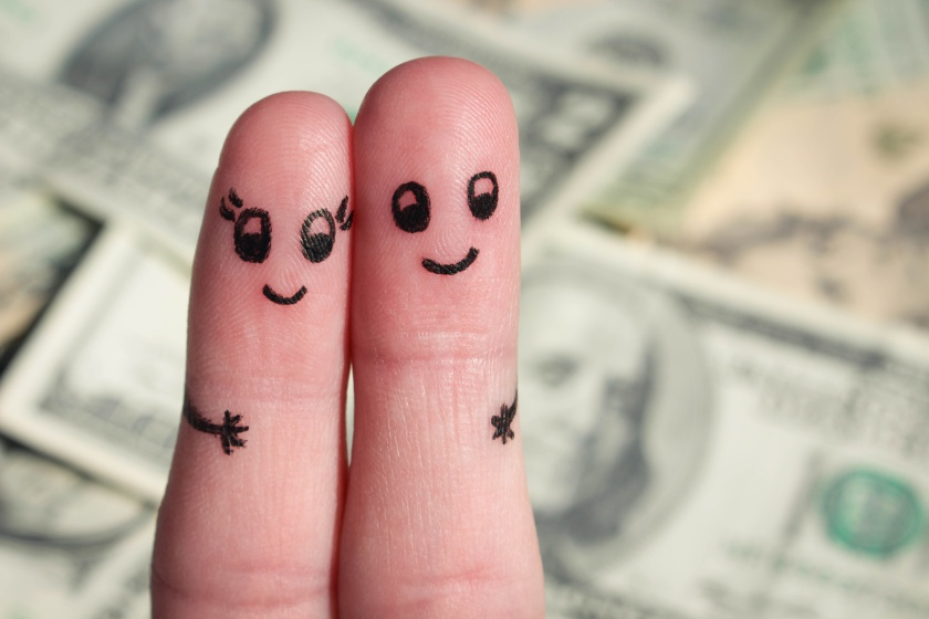 Finger art of a Happy couple hug on background of money.